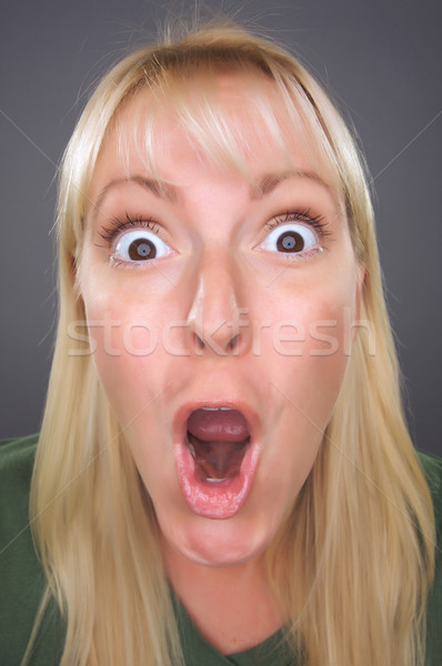 Shocked Blond Woman with Funny Face Stock photo © feverpitch