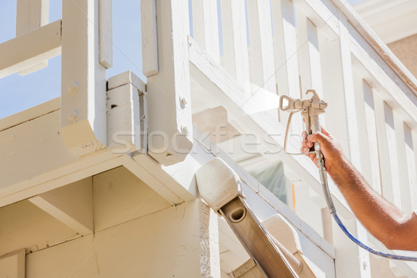 Professional House Painter Wearing Facial Protection Spray Paint Stock photo © feverpitch