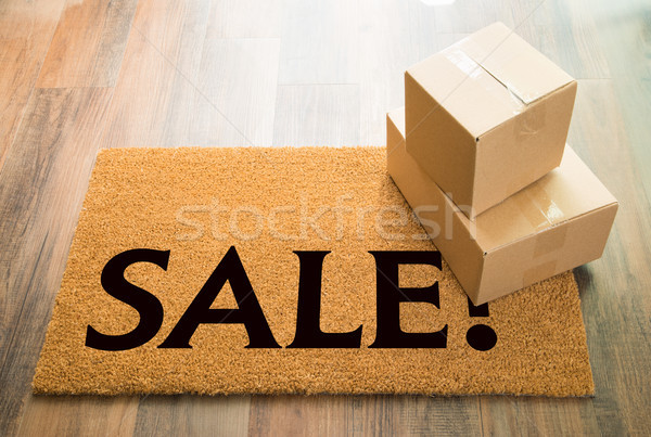 Sale Welcome Mat On Wood Floor With Shipment of Boxes Stock photo © feverpitch