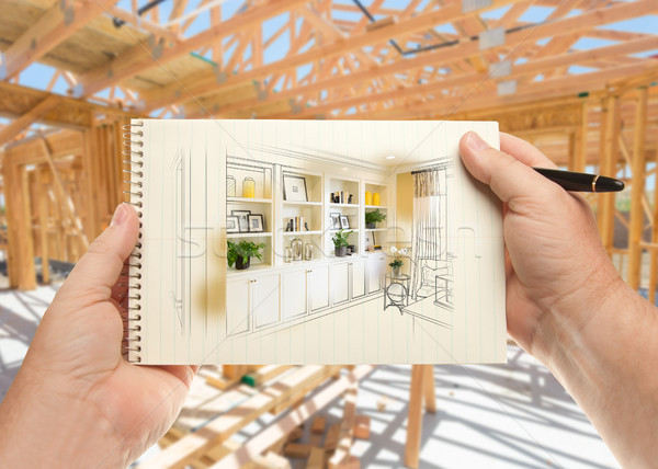 Hands Holding Pen and Pad of Paper with Built-in Shelves and Cab Stock photo © feverpitch