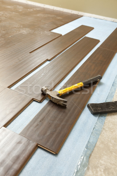 Hammer and Block with New Laminate Flooring Stock photo © feverpitch