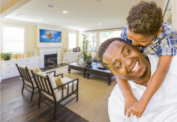 Afrian American Father and Mixed Race Son in Living Room Stock photo © feverpitch