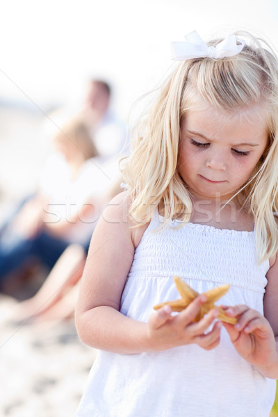 Adorable Little Blonde Girl with Starfish Stock photo © feverpitch