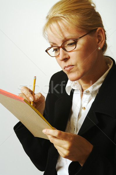 Beautiful Woman Thinks with Pencil & Notepad Taking Notes Stock photo © feverpitch