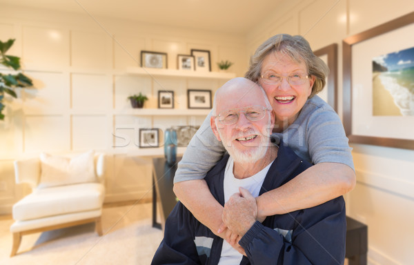 Loving Senior Couple Inside Their Home Office. Stock photo © feverpitch