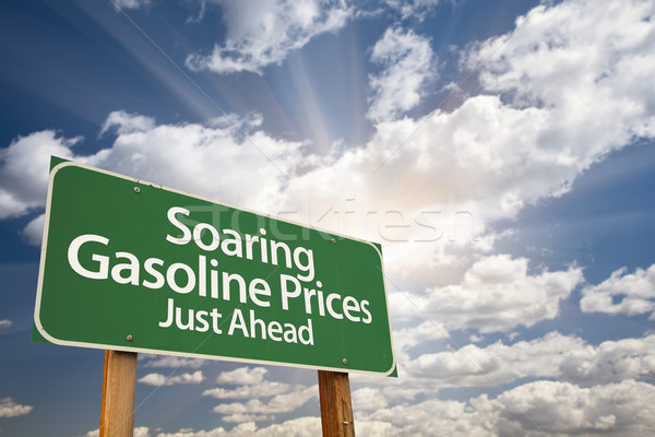 Soaring Gasoline Prices Green Road Sign and Clouds Stock photo © feverpitch