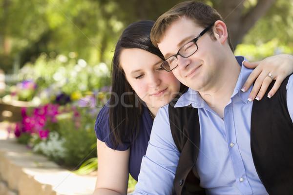 Jovem comprometido casal relaxante parque atraente Foto stock © feverpitch