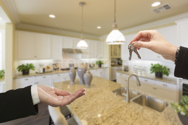 Handing Over New House Keys Inside Beautiful Kitchen Stock photo © feverpitch