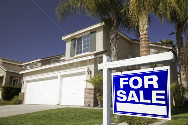 Stock photo: Blue For Sale Real Estate Sign and House
