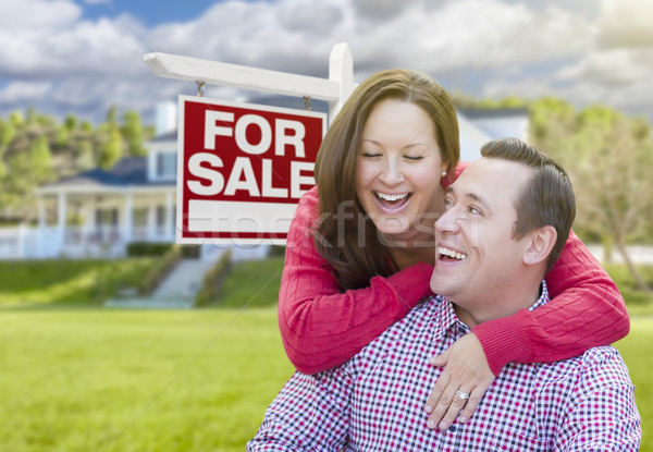 Happy Couple In Front of For Sale Sign and House Stock photo © feverpitch