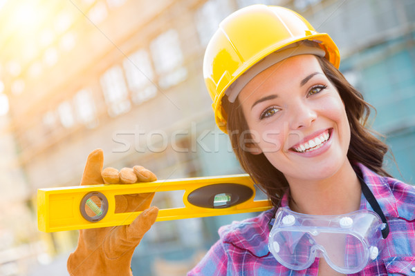 Stock photo: Portrait of Young Female Construction Worker with Level Wearing