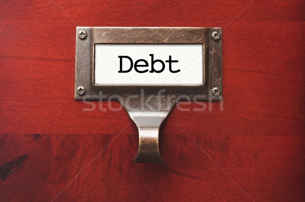 Lustrous Wooden Cabinet with Debt File Label Stock photo © feverpitch