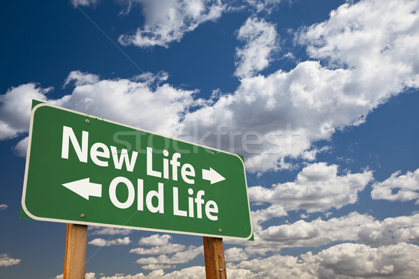 New Life, Old Life Green Road Sign Over Clouds Stock photo © feverpitch