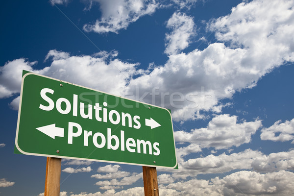 Solutions, Problems Green Road Sign Over Clouds Stock photo © feverpitch