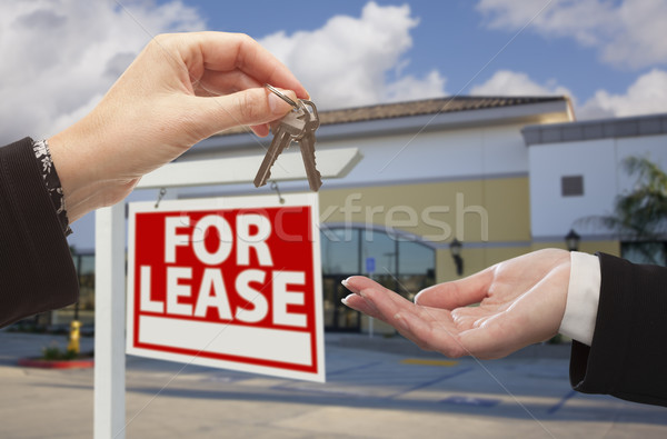 Stock photo: Handing Over Keys in Front of Business Office and Sign