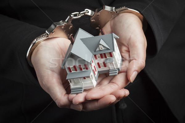 Woman In Handcuffs Holding Small House Stock photo © feverpitch