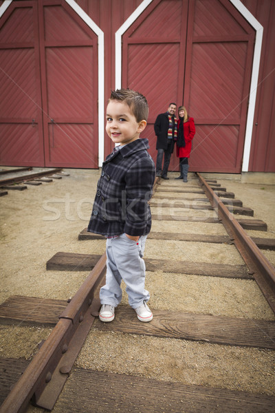 Mixed Race Boy at Train Depot with Parents Smiling Behind Stock photo © feverpitch