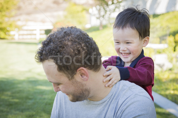 Caucasian Father Having Fun with His Mixed Race Baby Son Stock photo © feverpitch