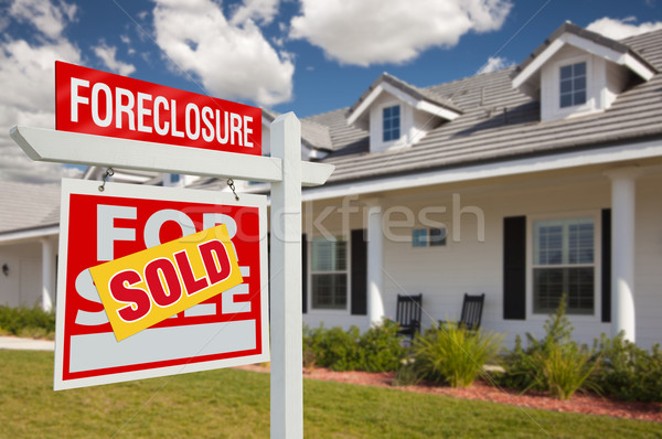 Sold Foreclosure Real Estate Sign and House - Left Stock photo © feverpitch