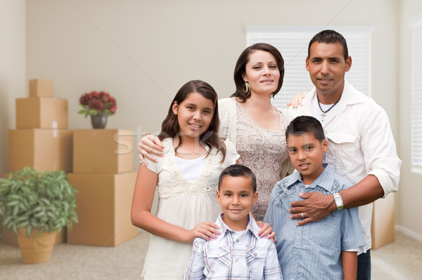 Hispanic Family in Empty Room with Packed Moving Boxes and Potte Stock photo © feverpitch