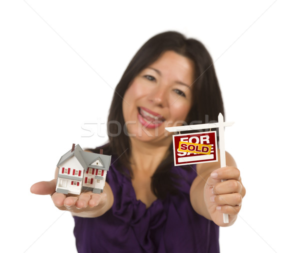 Multiethnic Woman Holding Small Sold For Sale Real Estate Sign a Stock photo © feverpitch