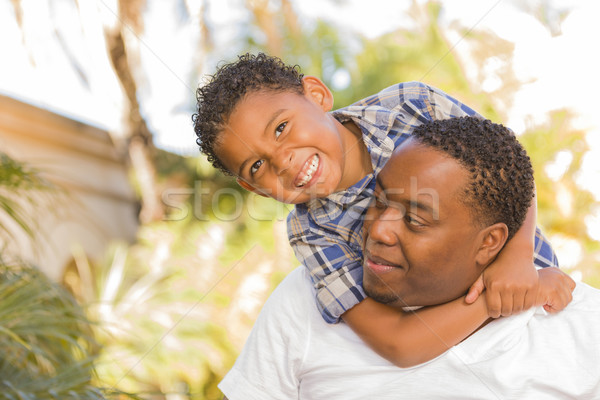 Mixed Race Father and Son Playing Piggyback Stock photo © feverpitch
