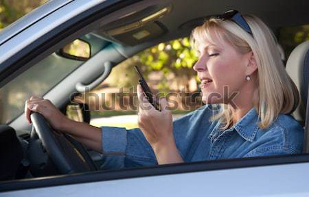 Mixed Race Woman Texting and Driving Stock photo © feverpitch