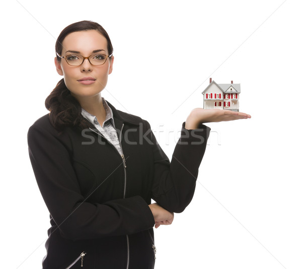 Stock photo: Mixed Race Businesswoman Holding Small House to the Side