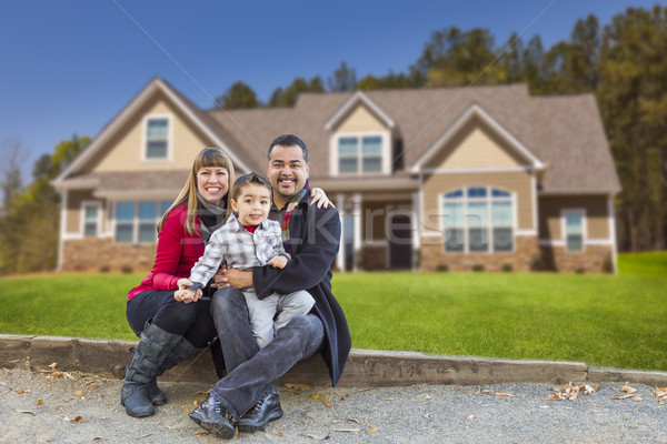 Mixed Race Family in Front of Their New Home Stock photo © feverpitch