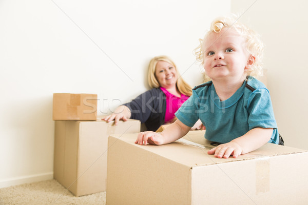 Happy Mother and Son in Empty Room with Moving Boxes Stock photo © feverpitch