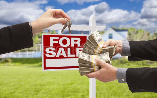 Handing Over Cash for Keys in Front of House, Sign Stock photo © feverpitch