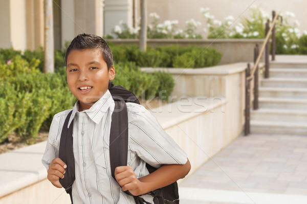 Happy Hispanic Boy with Backpack Walking on School Campus Stock photo © feverpitch