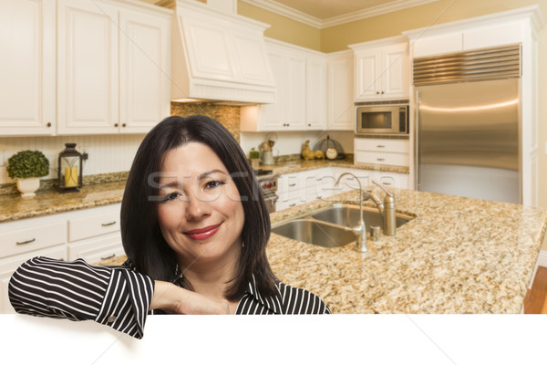 Hispanic Woman Leaning Against White In Custom Kitchen Interior Stock photo © feverpitch
