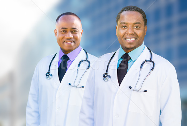African American Male Doctors Outside of Hospital Building Stock photo © feverpitch