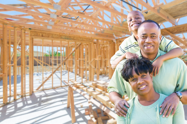 Young African American Family On Site Inside Their New Home Cons Stock photo © feverpitch