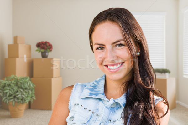 Mixed Race Young Girl Inside Empty Room wioth Moving Boxes Stock photo © feverpitch
