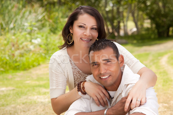 Feliz casal parque afetuoso hispânico grama Foto stock © feverpitch