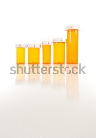 Empty Medicine Bottles on Reflective Surface Stock photo © feverpitch