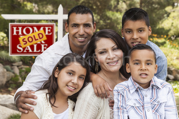 Hispanic Family in Front of Sold Real Estate Sign Stock photo © feverpitch