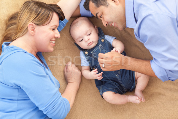 Mixed Race Family Playing on the Blanket Stock photo © feverpitch