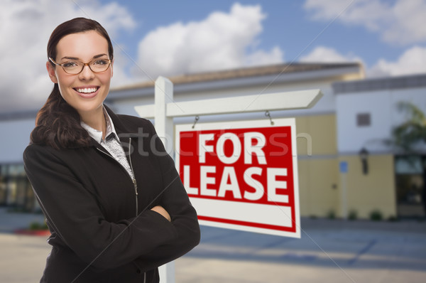 Woman In Front of Commercial Building and For Lease Sign Stock photo © feverpitch