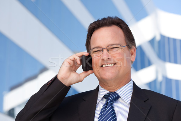 Businessman Smiles as He Talks on His Cell Phone Stock photo © feverpitch