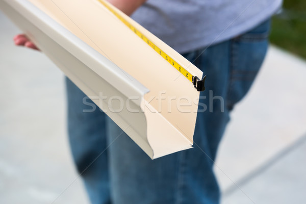 Worker Measuring Rain Gutter Processing Through Seamless Shaping Stock photo © feverpitch