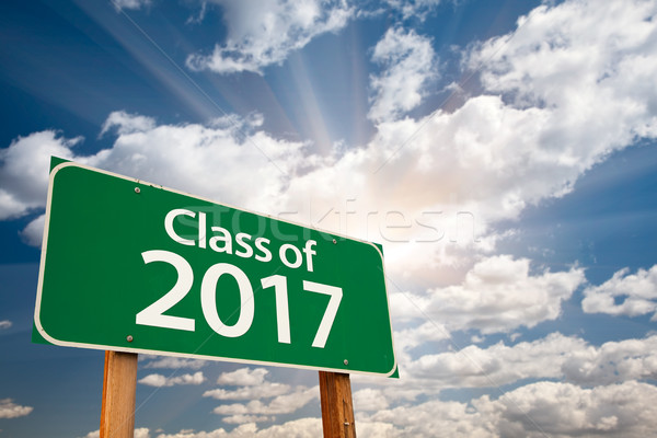 Class of 2017 Green Road Sign with Dramatic Clouds and Sky Stock photo © feverpitch
