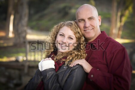 Attractive Couple in Park with Leather Jackets Stock photo © feverpitch