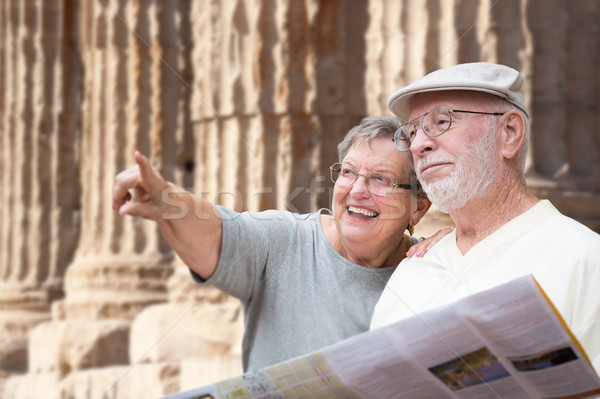 Happy Senior Adult Couple Tourists with Brochure Next To Ancient Stock photo © feverpitch
