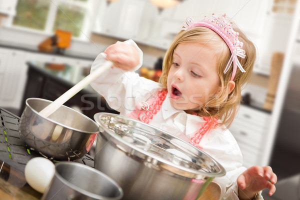 Stock photo: Cute Baby Girl Playing Cook With Pots and Pans In Kitchen