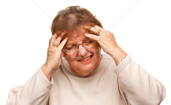 Senior Woman with Aching Head on White Stock photo © feverpitch