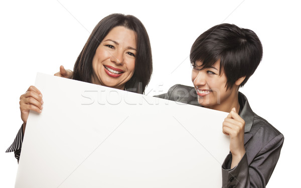 Attractive Mixed Race Mother and Daughter Holding Blank White Si Stock photo © feverpitch