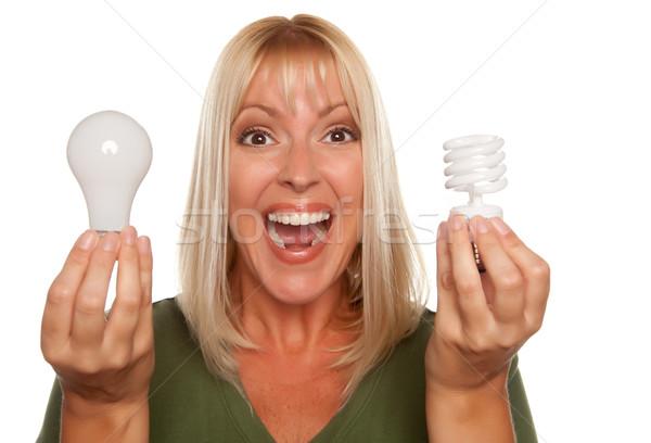 Kadın enerji düzenli ampuller yalıtılmış Stok fotoğraf © feverpitch